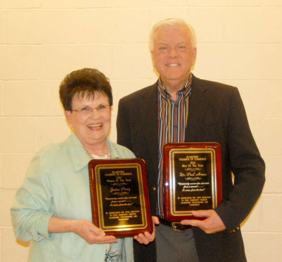 Janice Posey and Dr. Paul Armes show their plaques after being recognized at Monday's Chamber of Commerce Banquet as Plainview's Woman and Man of the Year for 2012. The banquet was held at the Laney Center on the Wayland Baptist University campus. Photo: Doug McDonough