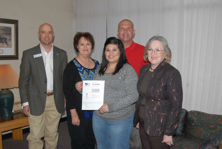 The Texas Historical Commission's Texas Main Street Program recognized Plainview's Main Street board earlier this month for its dedication to persevering and reviving downtown Plainview in 2014. Pictured are members of the 2014 board Matt Kelly (left), Kay Harris, former Main Street manager Sarah Castillo, Chris LeFevre and Janice Payne. Not shown is Teressa King, Diane Book, Michael Graves, Debbie McPherson and Frances Barrera. Photo: Homer Marquez/Plainview Herald