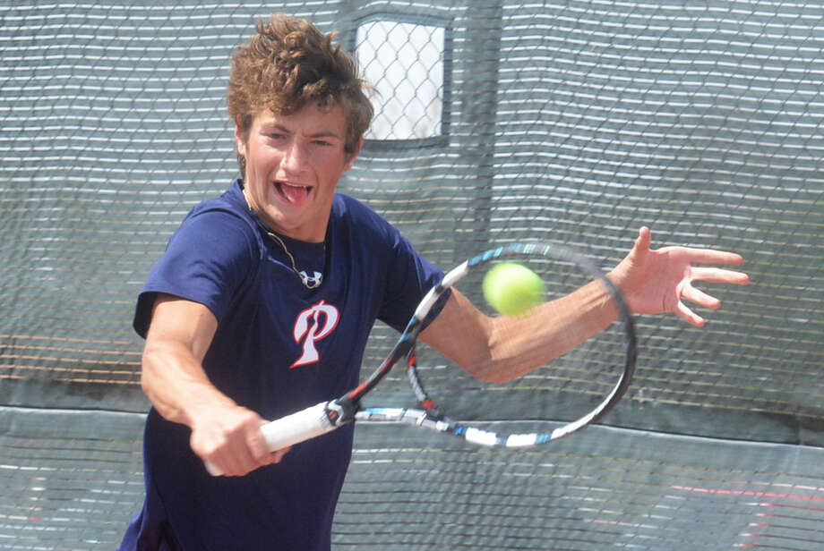Plainview's Grant Thomas, shown hitting a backhand during the District 4-5A Tennis Tournament, finished third in boys singles and will be an alternate to the regional tournament. Photo: Skip Leon/Plainview Herald