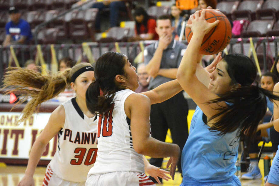 Plainview's Brittany Rincon (10) puts pressure on an El Paso Chapin player as teammate Jaden Gonzales (30) closes in to make a play during an area round playoff game Friday. The Lady Bulldogs expect a battle when they take on El Paso Eastlake in a regional quarterfinal game Tuesday. Photo: Doug McDonough/Plainview Herald