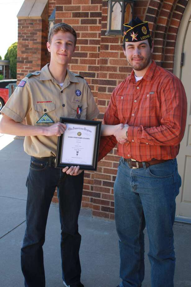 "John O'Connell, vice commander American Legion Post 141, Lockney, presents Jake Moore with the American Legion Citizenship Award. The presentation was made at the conclusion of Moore's Eagle Scout Court of Honor Sunday, April 3, at the First United Methodist Church in Lockney. Eagle Scout is the highest rank in Boy Scouts. At the ceremony each parent is presented with a pin to acknowledge their efforts in his achievement. Jake is the son of Sam and Dr. Shari Moore, scoutmaster of Boy Scout Troop 259 in Lockney. His grandfather, the late Sam Moore Jr., was a member of Post 141. Ed Marks, post commander, commented, ""We have watched Jake develop into a fine young man. The American Legion is proud to support the Boy Scouts."""