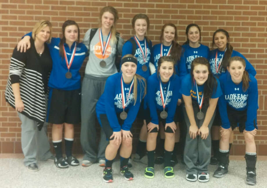 The Plainview Christian Academy Lady Eagles wear the medals they earned for reaching the TAPPS Class A state semifinals. Plainview Christian Academy gave three-time defending state champion Granbury Happy Hill Academy all it could handle Friday afternoon before losing a heartbreaking 44-42 decision. Photo: Carmen Ortega/Plainview Herald
