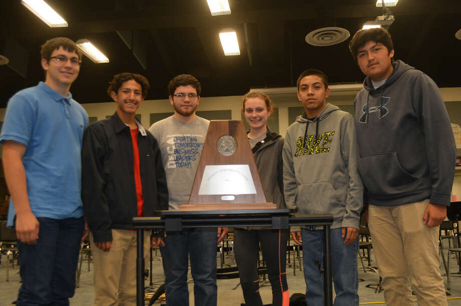 Sweepstakes Honors Doug McDonough/Plainview Herald Gathering around the UIL Sweepstakes trophy earned Tuesday at concert and sightreading contest at Frenship are Plainview High School Honors Band members Colton Langston (left), Sebastian Ramos, John David Andrade, Deidre Howard, Marco Martinez and Fernando Flores. To earn Sweepstakes, a band must receive Division I ratings in the same year in marching, concert and sightreading contests. The PHS Powerhouse of the Plains/Honors Band has done that seven consecutive times and 75 times while earning a record 78 consecutive Division I ratings in UIL marching competition.