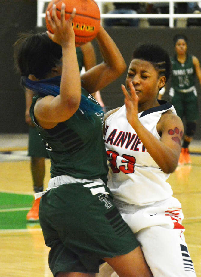 Plainview's Khyra Riddley (right) stops a Trimble Tech player in her tracks during the Region 1-5A semifinals in Snyder Friday. Trimble Tech knocked Plainview out of the tourney with a 63-48 victory. Photo: Doug McDonough/Plainview Herald