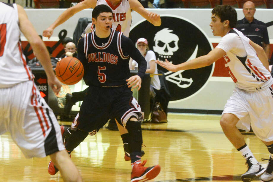 Plainview's Jayton Ellis dribbles through the Lubbock Cooper defense during a game earlier this season. The Bulldogs' 5-foot-8 junior point guard was voted the Most Valuable Player in District 4-5A. Photo: Skip Leon/Plainview Herald