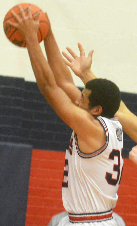 Plainview's Marc Wallace, shown grabbing a rebound during a game this past season, was one of 12 local and area players named to the Texas Association of Basketball Coaches (TABC) Academic All-State team. Photo: Skip Leon/Plainview Herald