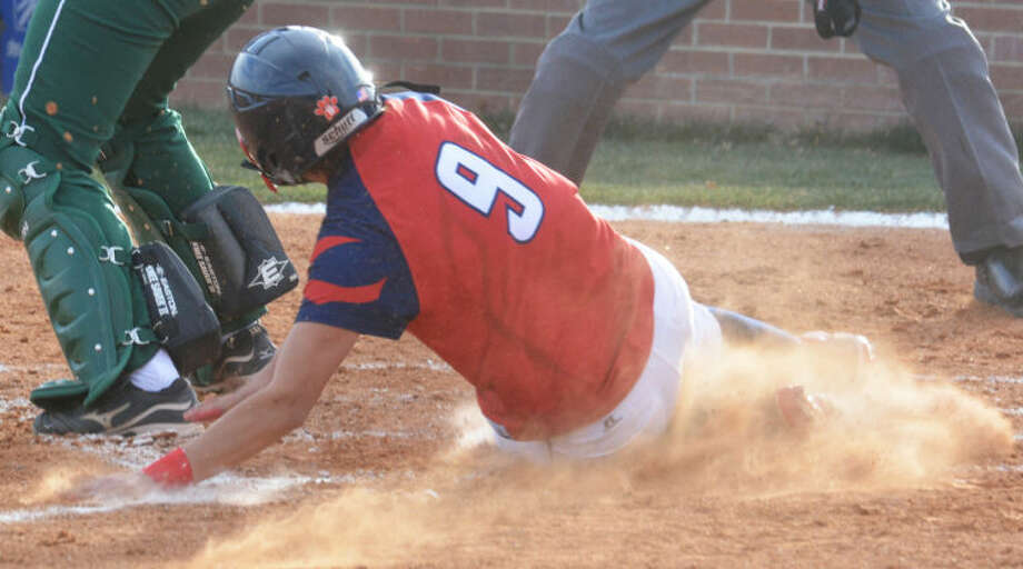 Plainview's Averee DeLuna slides home with the only run of the game in the third inning Tuesday. The Lady Bulldogs evened their record at 9-9 with a 1-0 victory over Pampa in their regular-season home opener. Photo: Skip Leon/Plainview Herald