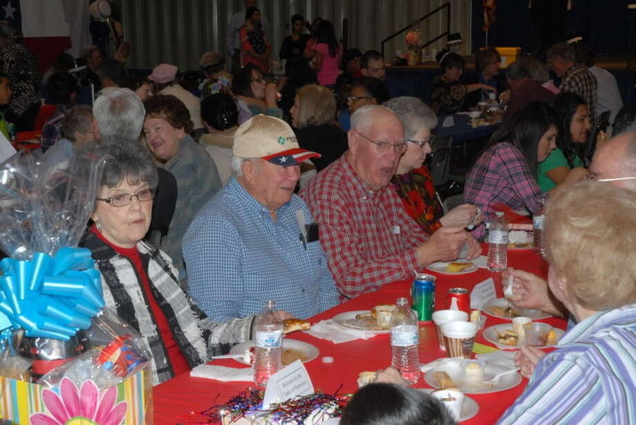 "A festive crowd celebrates ""Hats Off to Plainview"" with food, entertainment and door prizes."
