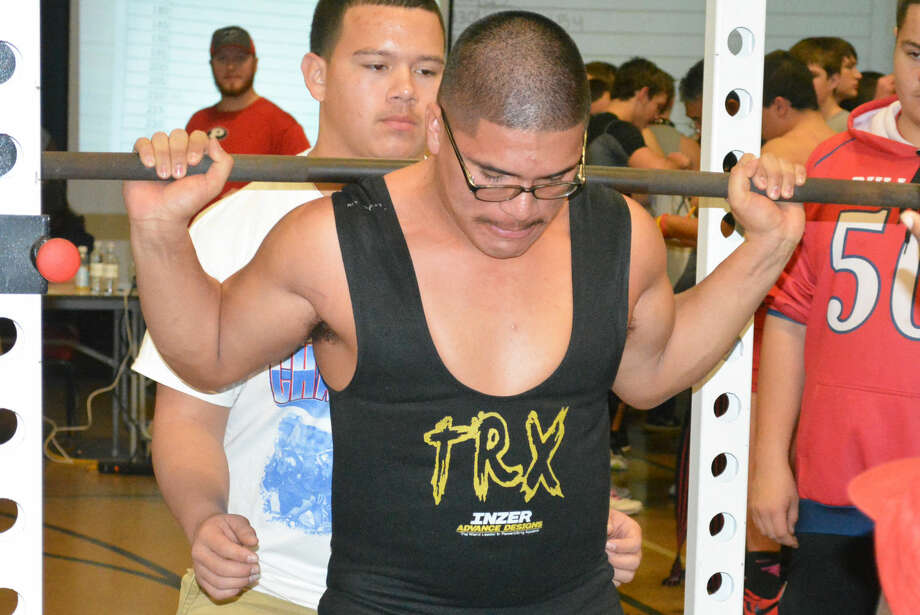 Plainview's Domingo Saucedo prepares to execute a lift during the Bulldog Powerlifting Meet earlier this season. The Bulldog athletes are currently soliciting pledges for their first-ever Lift-A-Thon fundraiser. The weight lifting will be done Monday through Wednesday. Photo: Skip Leon/Plainview Herald