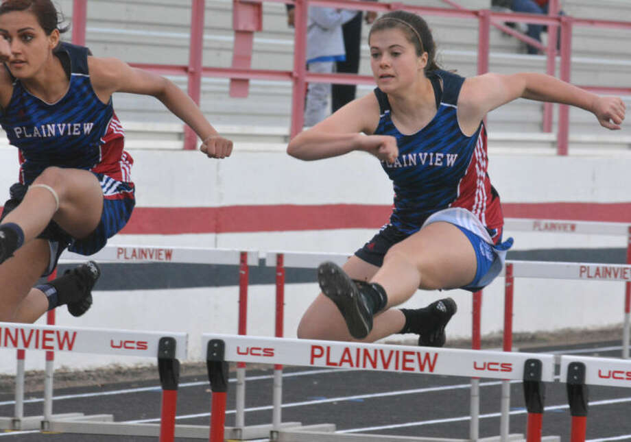 Brooke Walker (right) and Harlee Davis (left) race in the 110-meter hurdles at the Reagor-Dykes Bulldog Relays Friday. Walker finished second in the race and Davis was third. Photo: Skip Leon/Plainview Herald