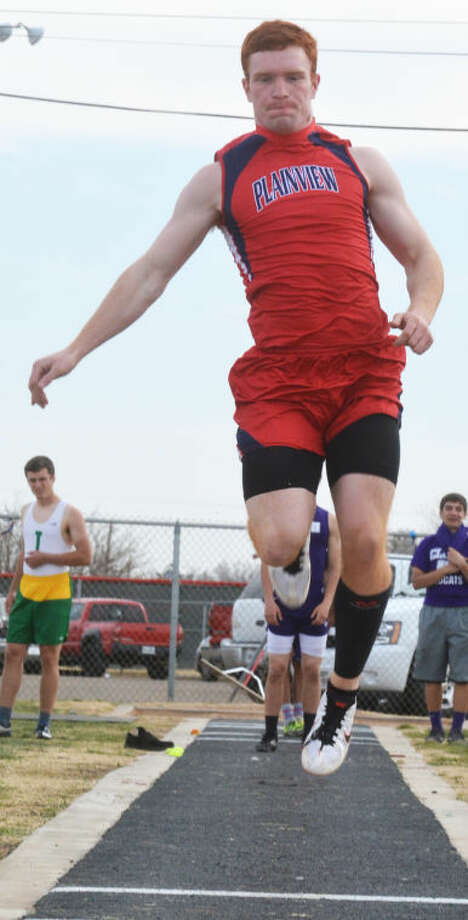 Dakota Crawford takes to the air in winning the triple jump at the Reagor-Dykes Bulldog Relays Friday. Crawford also ran on a winning relay team to help the Bulldogs to the team championship in the meet. Photo: Skip Leon/Plainview Herald