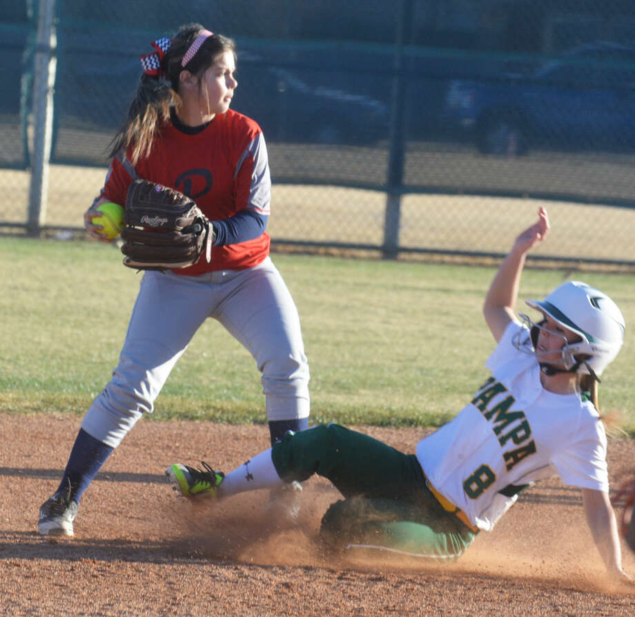 Plainview infielder Morgan Chapa tries to turn a double play in the face of a sliding Pampa runner during a scrimmage earlier this season. The Lady Bulldogs split two games at the Panhandle Showdown Friday. They are slated to play their first home game of the season Tuesday. Photo: Skip Leon/Plainview Herald
