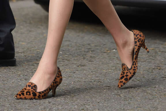 Power dressing may be getting a new bounce thanks to Theresa May, who wore her signature kitten-heel, leopard-print shoes July13, her first day as prime minister of the United Kingdom.