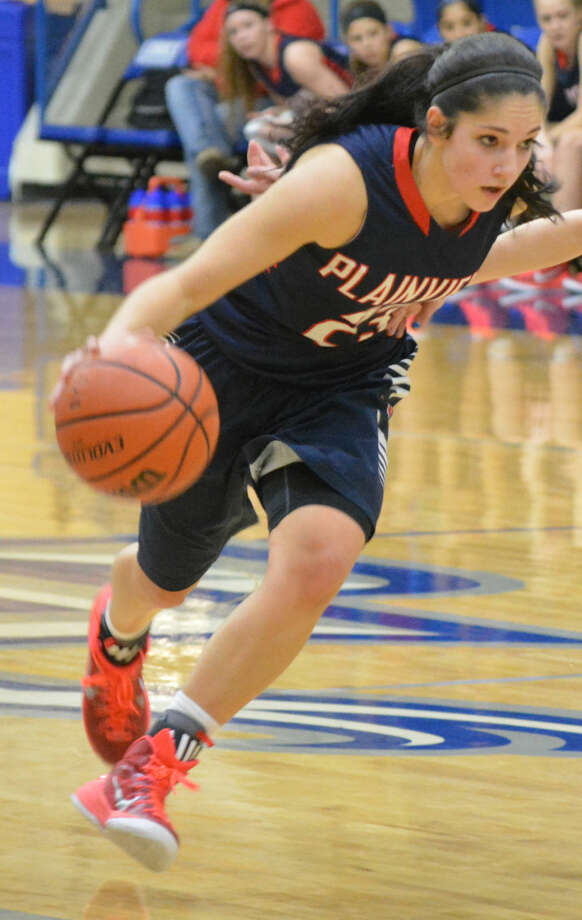Plainview's Karli Wheeler dribbles in a game during the recently completed season. The 5-foot-8 senior point guard was named to the Texas Girls Coaches Association (TGCA) all-state team for the fourth consecutive year. Photo: Doug McDonough/Plainview Herald