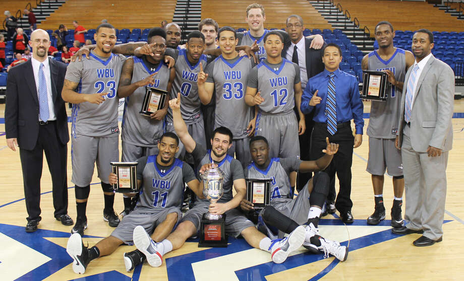 The Wayland Baptist University basketball team celebrates its first-ever Sooner Athletic Conference championship in Oklahoma City Saturday. The Pioneers steamrolled Mid-America Christian, 94-60, in the championship game. Photo: Courtesy Photo