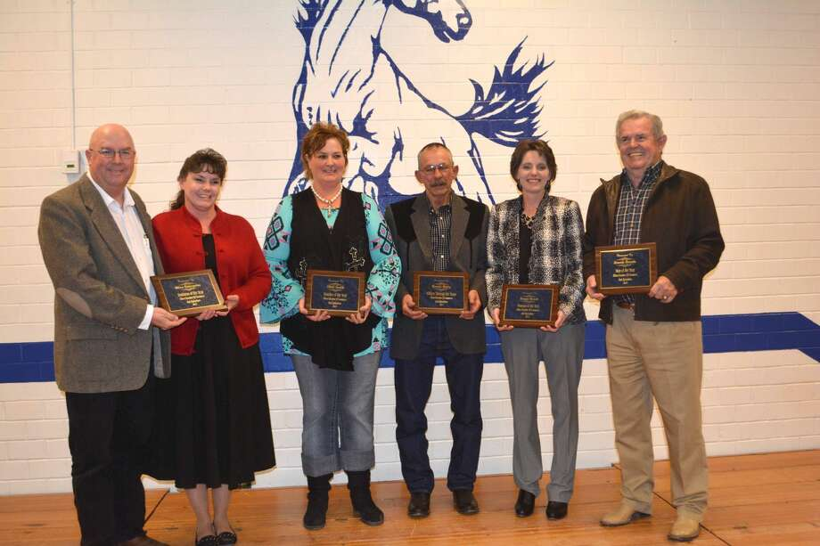 Doug McDonough/Plainview Herald Major award recipients Saturday at the Olton Chamber of Commerce Banquet include Phillip and Ursula Hamilton (left) of the Olton Enterprise, Business of the Year; Nikki Smith, Teacher of the Year; Ronnie Digby, Citizen Through The Years; Tonya Noack, Woman of the Year; and Ronnie Dennis, Man of the Year.