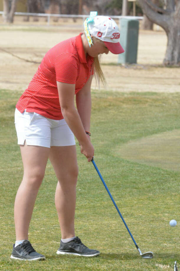 Plainview golfer Caroline Kinkaid chips onto the green on No. 18 in the opening round of the District 4-4A golf season at Plainview Country Club Monday. Kinkaid carded an 81 and is tied for third place just two strokes off the lead. Photo: Skip Leon/Plainview Herald