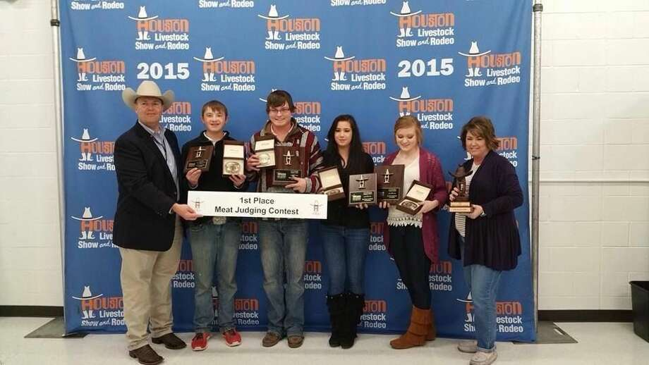 Top 4-H TeamHouston Rodeo and Stock Show PhotoHale County 4-H's Senior Meat Judging Team, composed of Zachary McDonough, Logan Mustian, Miranda Hastey and Layne Mustian, took first place in the 4-H Division of the Houston Rodeo and Stock Show Meat Judging Contest on Sunday in Houston. Logan Mustian (center) was first place individual; Layne Mustian (second from right); second place; Hastey, seventh; and McDonough, 13th. They won first place team belt buckles, plaques for their individual placings and the team trophy, displayed by sponsor Dawn Mustian (right). Two weeks ago, the team placed second in the same event at the San Antonio Stock Show. Their coach is Jessica Igo Finck.