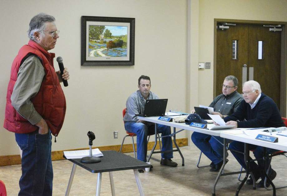 Doug McDonough/Plainview HeraldSilverton area farmer Gary Weaks on Friday urges High Plains Underground Water District directors to reject a recommendation by the Texas Commission on Environmental Quality to annex western Briscoe County during a public hearing and board meeting in Tulia. The board, including Ronnie Hopper (right) of Petersburg, sided with Weaks by voting unanimously to reject TECQ's recommendation.