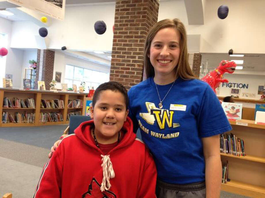 Wayland Baptist Flying Queen Georgia Ann Tucker, a sophomore from Fort Sumner, N.M., poses with a student at Peaks Mill Elementary School in Frankfort, Ky. Members of the Flying Queens read with students at the school on Tuesday as part of the NAIA's Champions of Character initiative. The Queens play Lewis-Clark State College of Idaho at 11 a.m. Wednesday in the first round of the national tournament. Photo: Wayland Baptist University Photo