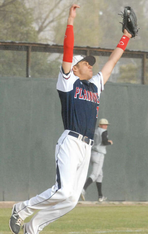 Plainview third baseman Ryan DeLeon leaps to snag a high chopper during the Bulldogs' opening District 4-4A game of the year against Lubbock High Tuesday. Photo: Skip Leon/Plainview Heral