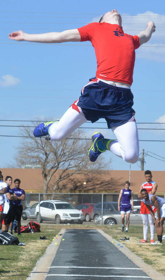 Plainview's Jayton Ellis achieves liftoff as he launches himself high into the air during the long jump at the Reagor-Dykes Bulldog Relays Friday. Photo: Skip Leon/Plainview Herald