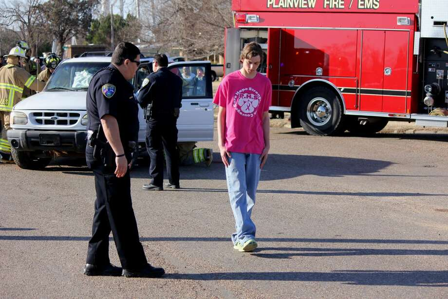 Curtis Bailey/Plainview ISDPHS student Bailly White, the alleged drunken driver in Wednesday's Shattered Dreams wreck recreation, is administered his sobriety test by Plainview police as other first responders treat the injured in the background.