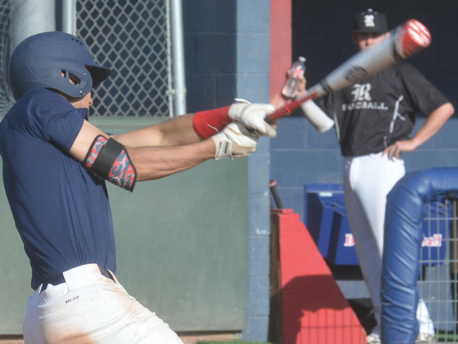 Plainview's Ryan DeLeon follows through on a swing during a baseball scrimmage earlier this season. DeLeon knocked in two runs and was the winning pitcher against El Paso El Dorado, one of two Bulldog victories on the opening day of a tournament in Lubbock. Photo: Skip Leon/Plainview Herald
