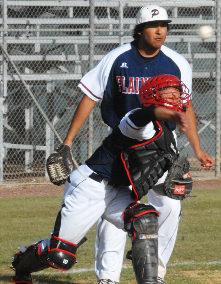 Plainview catcher Gabriel Chavez throws to first base as Bulldog pitcher Aaron Gonzalez looks on during the opening District 4-4A game of the season in Plainview Tuesday. Photo: Skip Leon/Plainview Herald