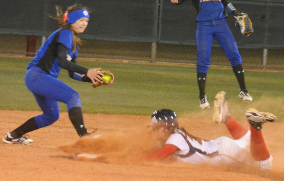 Plainview's Lori Gonzalez dives safely into second base just ahead of the Frenship shortstop during the eighth inning of a District 4-4A softball game at Lady Bulldog Park Friday night. Photo: Skip Leon/Plainview Herald