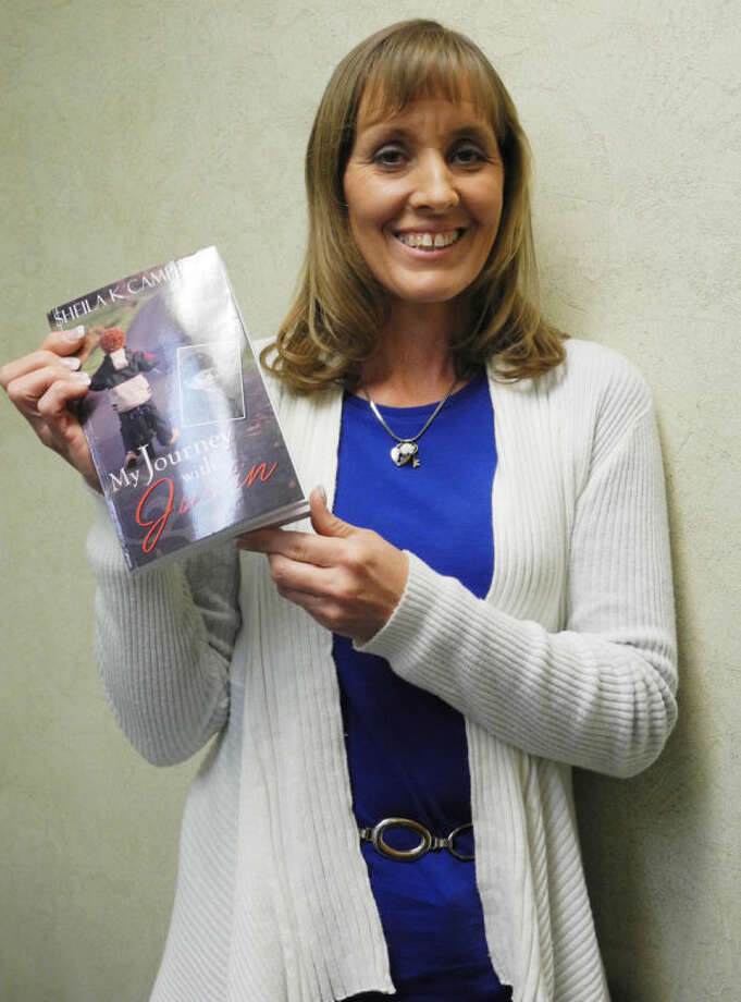 "Sheila K. Campbell is shown with her newly published book, ""My Journey With Justin,"" which tells about God's sovereignty during a child's illness and eventual death. Photo: Gail M. Williams 