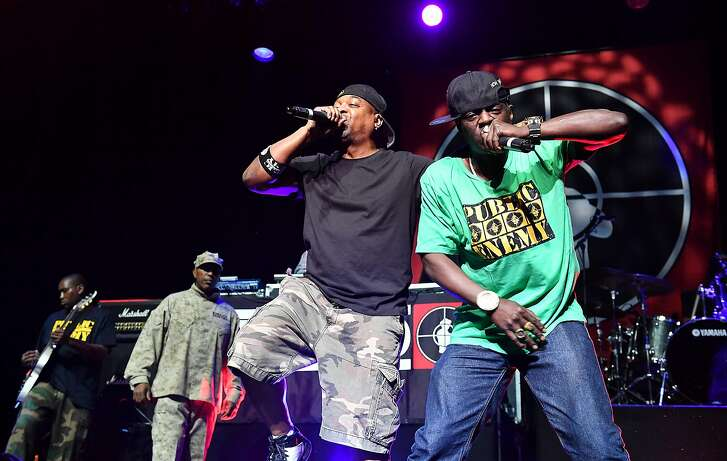 Rappers Flavor Flav, right, and Chuck D of the band Public Enemy perform at the O2 Arena in London, Thursday, June 16, 2016. (Photo by Mark Allan/Invision/AP)