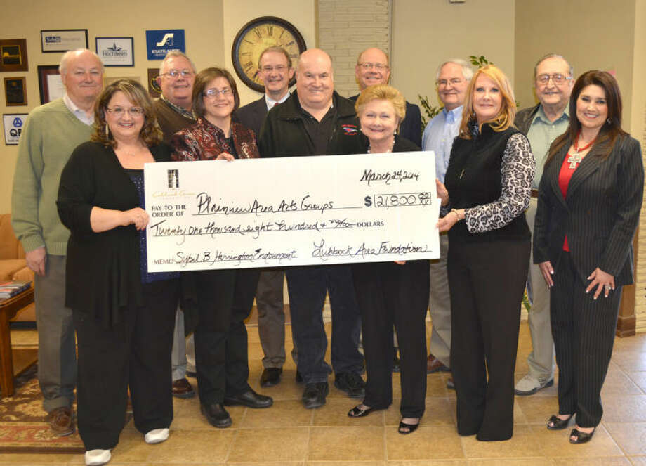 Doug McDonough/Plainview HeraldGrants totaling $21,800 were announced Monday by the Lubbock Area Foundation and Plainview Area Endowment, which will benefit two local organizations. The Plainview Community Concert Association received $20,000 while Wayland's Children's Chorus of Plainview received a $1,800 grant. On hand for Monday's announcement were Debbie Buford (front left), Children's Chorus director; Dr. Ann Stutes, dean of Wayland's School of Music; Mike McDonough; Plainview Community Concerts president; Alice Sawayer, Community Concerts officer; Sheryl Cates, Lubbock Area Foundation president; Frances Barrera, Plainview Area Endowment board member; John Tye (standing left), Plainview Area Endowment advisory board chairman; and board members Mark Warren, Willis McCutchen, Mike Fox, Roy Kiser and J.W. Hamby.