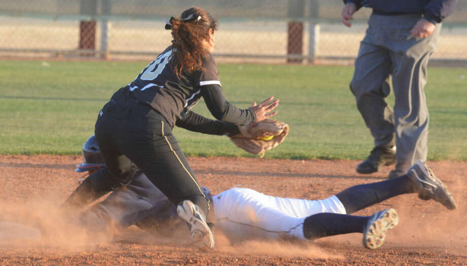 Plainview's Amy Hinojos dives into second base ahead of the Lubbock High shortstop's tag for a stolen base in the third inning of a District 4-4A softball game at Lady Bulldog Park Tuesday. Photo: Skip Leon/Plainview Herald