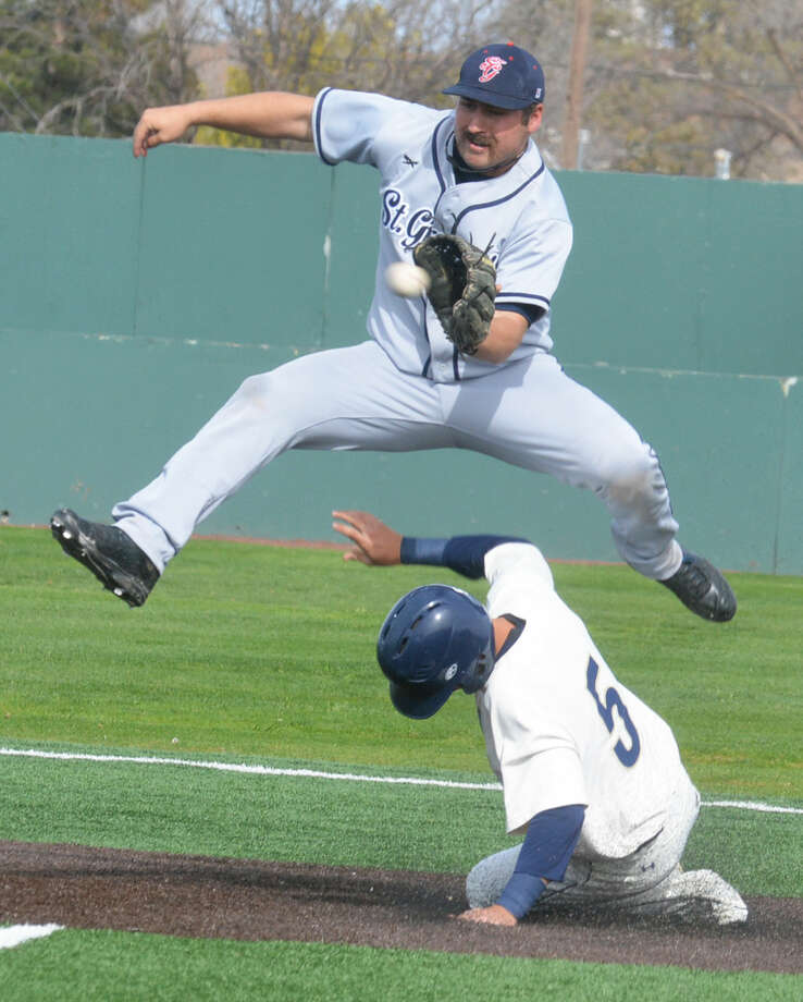 Wayland Baptist University's Colton Palmer steals second base as the St. Gregory's shortstop leaps to avoid his slide and catch the late throw. The Pioneers swept St. Gregory's in a Sooner Athletic Conference doubleheader. Photo: Skip Leon/Plainview Herald
