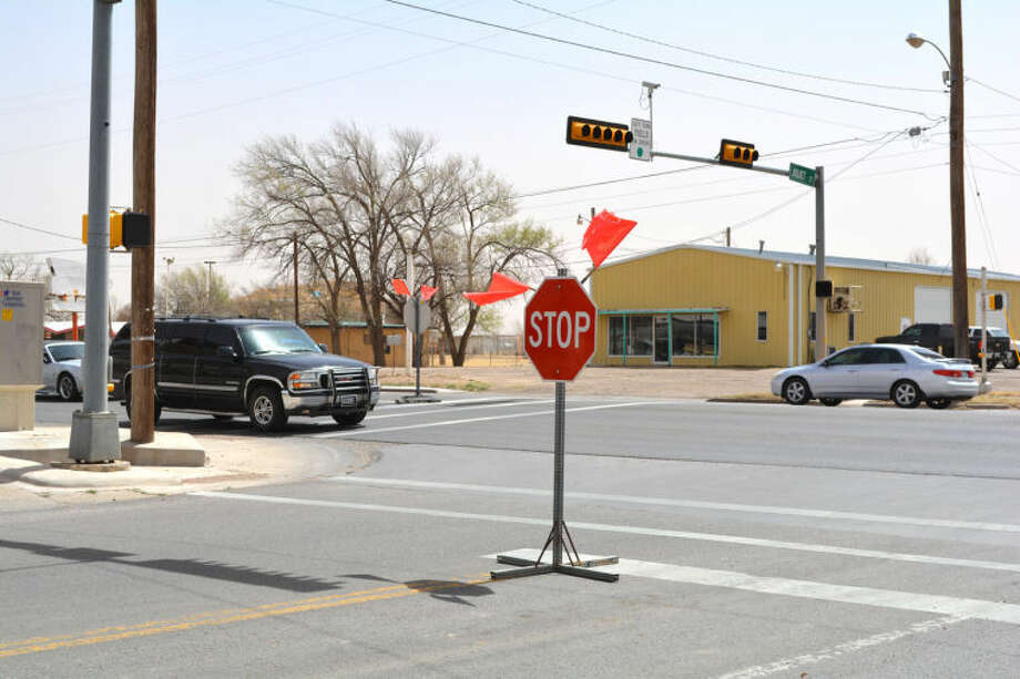 Doug McDonough/Plainview HeraldFour-way stop signs went up at several busy intersections, include Fifth and Joliet, Thursday afternoon due to various power outages. They occurred while the city was being buffeted by strong westerly winds with gusts up to 45 mph.