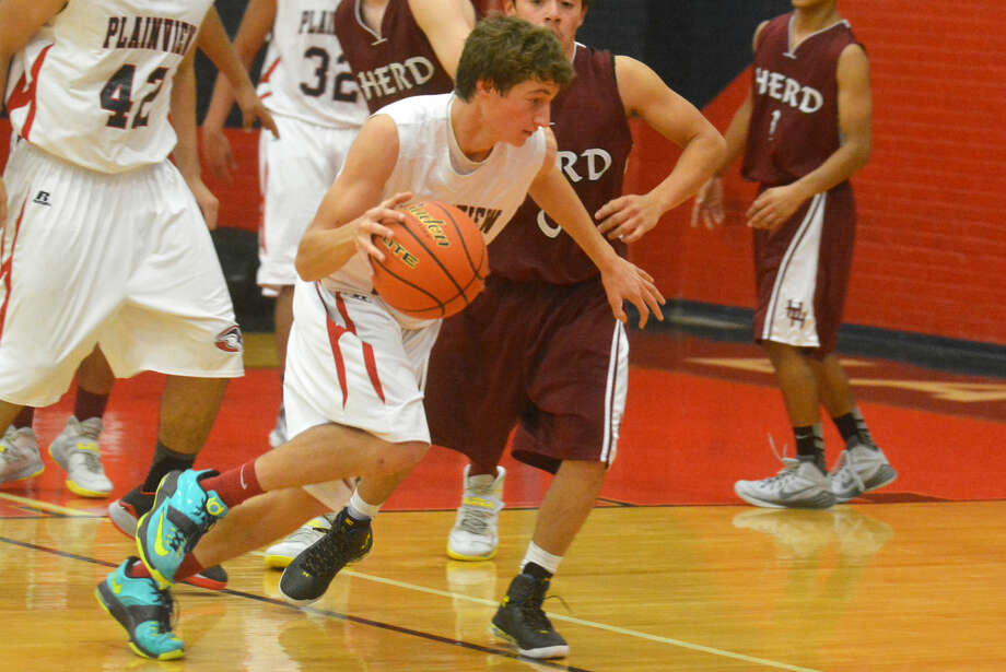 Plainview junior varsity basketball player Grant Thomas dribbles around an opponent during a game this season. The Plainview freshmen, junior varsity and varsity teams all won district championships and all won more than 20 games. Photo: Skip Leon/Plainview Herald