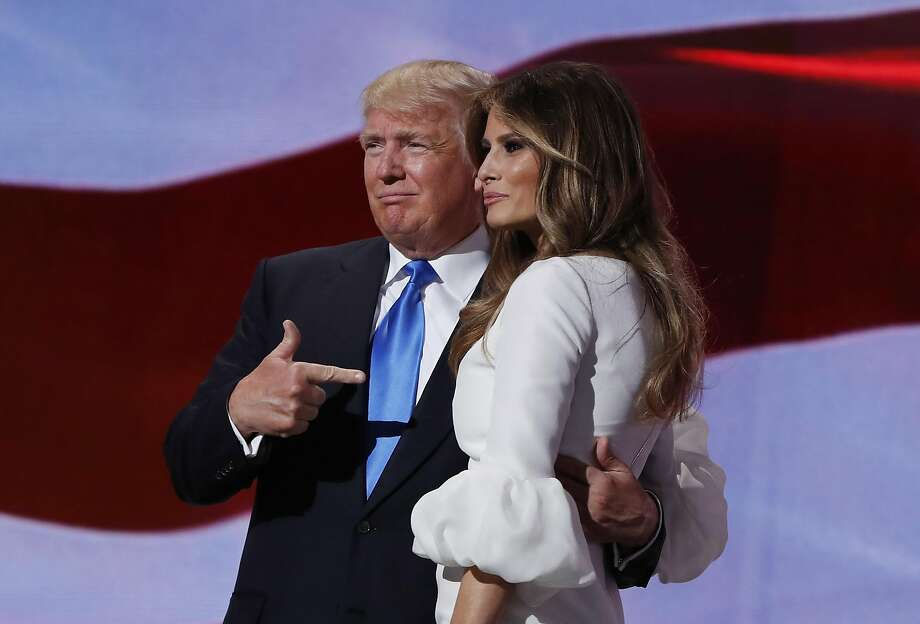Republican presidential candidate Donald Trump, right, stands with his wife Melania on stage after introducing her during the Republican National Convention, Monday, July 18, 2016, in Cleveland. (AP Photo/Carolyn Kaster) Photo: Carolyn Kaster, Associated Press