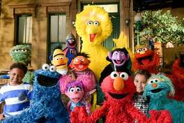 """This image released by the Sesame Workshop shows the cast of """"Sesame Street."""" The popular children's show begins its 46th season on HBO on Saturday, Jan. 16, 2016. (Zach Hyman/Sesame Workshop via AP)"""