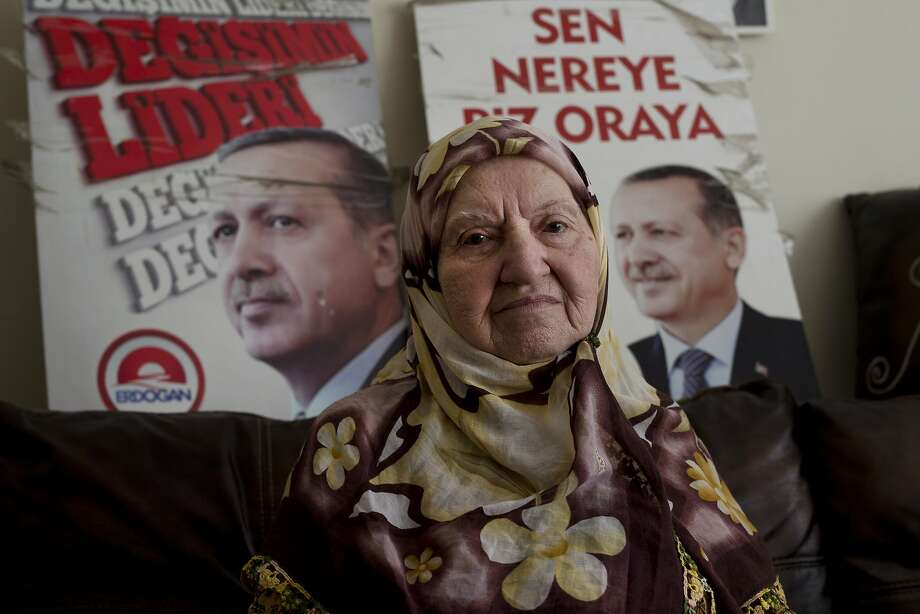 Ninety year-old Zelike Ergin, a former neighbour and supporter of Turkey's President Recep Tayyip Erdogan talks to The Associated Press in front of posters of him at her house, in Istanbul, Tuesday, July 19, 2016. For those who love him, a mix of the religiously conservative and the rising middle class, Turkish President Recep Tayyip Erdogan has been the powerhouse who drove economic success, gave Islam a greater role and boosted regional standing. (AP Photo/Petros Giannakouris) Photo: Petros Giannakouris, Associated Press