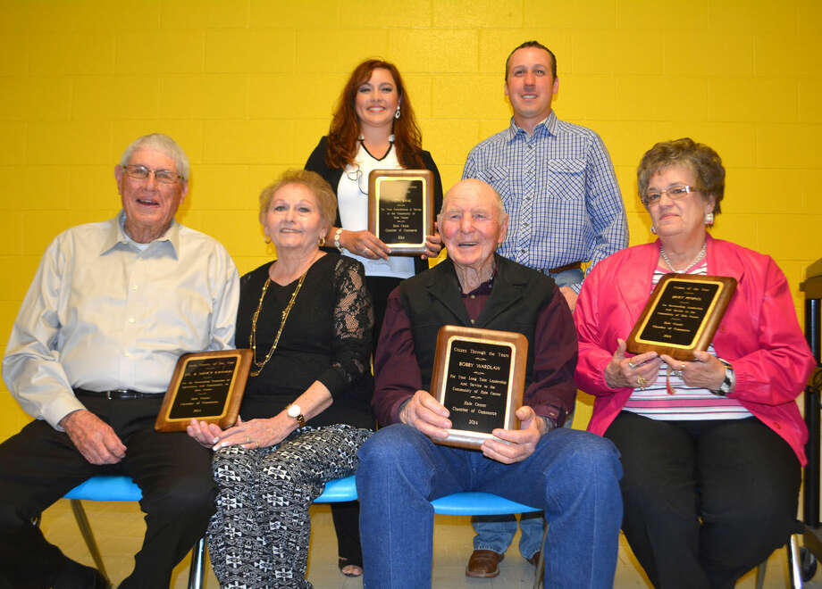 Award recipients at Saturday's Hale Center Chamber of Commerce Banquet include J.G. and Nancy Cannon (seated left), Farm Family of the Year; Bobby Wardlow, Citizen Through The Years; Janet Peoples, Citizen of the Year; and Wendy Baker and Travis Parker (standing), from Vista Bank, Business of the Year.