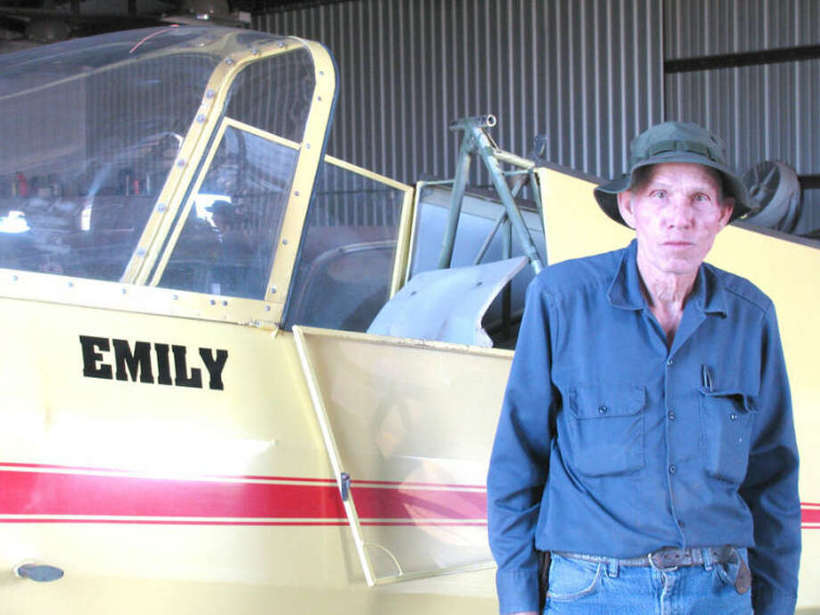 Plainview resident Eddie Hoglan, 79, stands in front of the training glider Emily in this photo. He and student pilot Taylor Brown of Littlefield were killed in a glider crash Saturday when a wing inexplicably separated from another glider during flight. Photo: Courtesy Photo