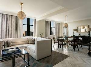Among the 299 rooms in the newly renovated Ritz-Carlton, Philadelphia, is the 1,235-square-foot Presidential Suite, which includes a spacious living and room (pictured) and sweeping skyline views.