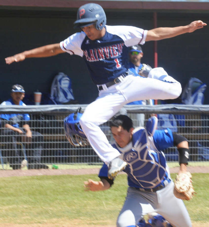 Plainview's Danny Martinez leaps over the San Angelo Lake View catcher to score a run on a close play at the plate in the sixth inning of the first game of a District 4-4A doubleheader Saturday afternoon at Bulldog Park. Photo: Skip Leon/Plainview Herald