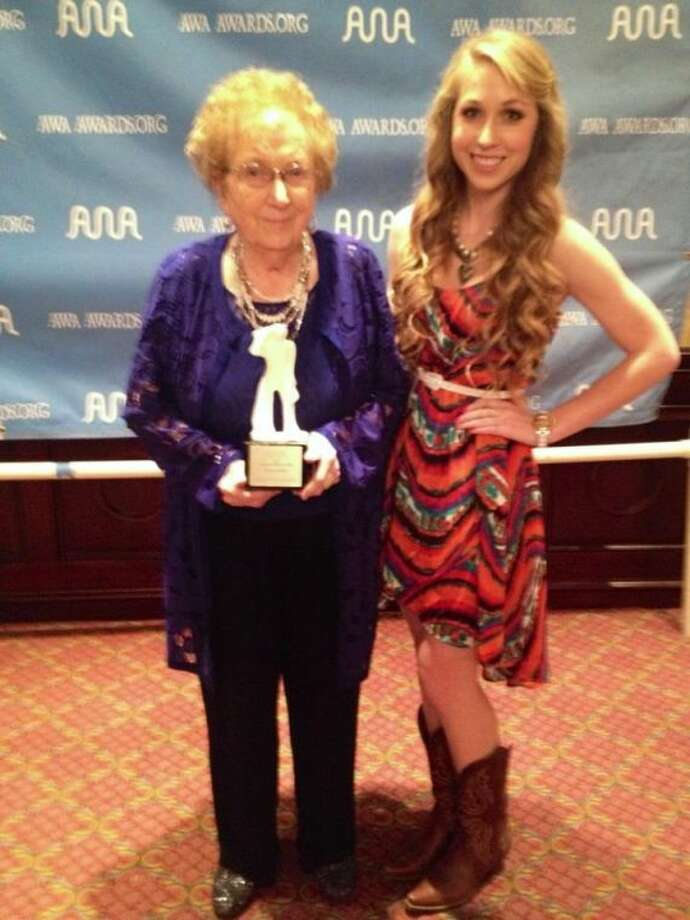 Lockney pianist Lucy Dean Record (left) received the Instrumentalist of the Year Saturday at the 18th Annual Academy of Western Artists Will Rogers Awards. Pictured with record is friend Melissa Conley. Photo: Courtesy Photo