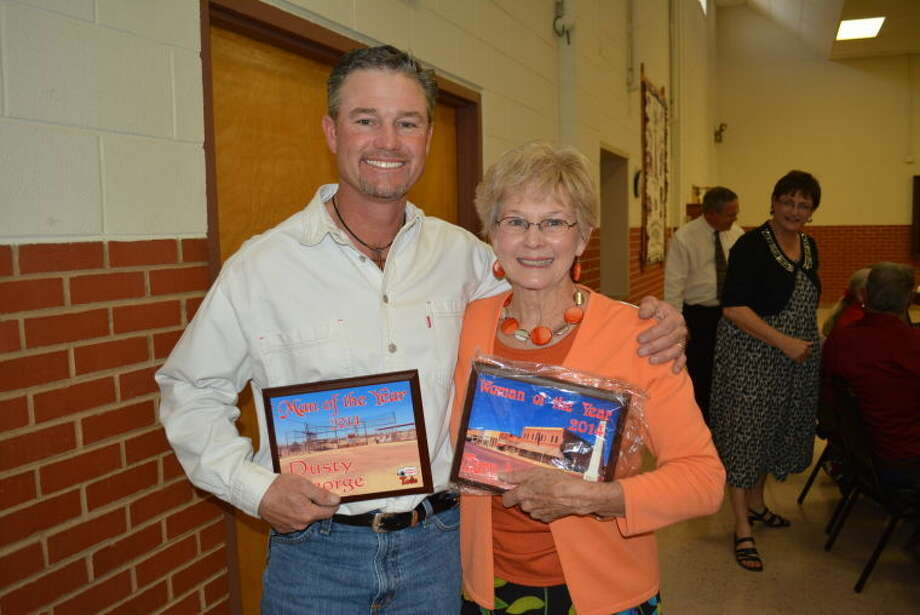 During Tulia's annual Chamber of Commerce banquet Thursday, Dusty George (left) was awarded the 2014 Man of the Year honor; along side Mary Lou Roach, who was the 2014 Woman of the Year. Other winners were Keeter's Meat Company, who was honored as the Business of the Year; Ross James, who received the 2014 Hustle for Tulia Award and Marie Rogers, who was given the Pioneer Spirit Award. Photo: Homer Marquez/Plainview Herald