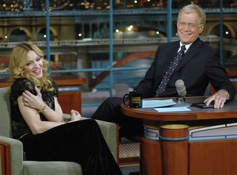 "FILE - In this Jan. 11, 2006 file photo released by CBS, Madonna joins host David Letterman on the set of ""The Late Show with David Letterman,"" in New York. Madonna was in town to attend a special screening of ""Arthur and The Invisibles."" Letterman announced his retirement during a taping on Thursday, April 3, 2014. Although no specific date was announced he told the audience that he will leave his desk sometime in 2015. (AP Photo/CBS, J P Filo, File) MANDATORY CREDIT; NO SALES; NO ARCHIVE; NORTH AMERICAN USE ONLY Photo: J P Filo / CBS"