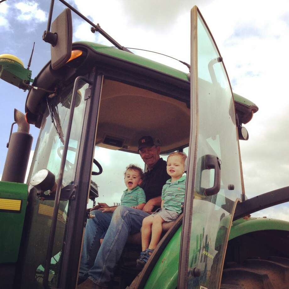 Hale County Farmer Tom Horsford gives his grandchildren a ride on his truck. Photo:  Courtesy Photo