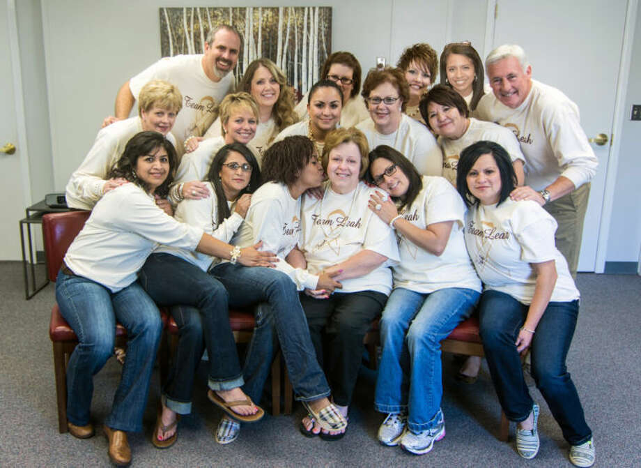 Plainview ISD staff shows its support for teacher Leah Dayton (center front) in her battle with lung cancer by purchasing Team Leah shirts that they wear during her chemo days. The shirts are ivory, the color designated for lung cancer. Photo: Courtesy Photo