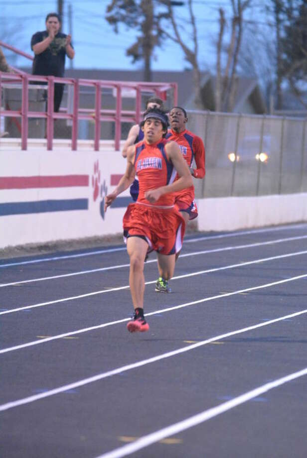 Plainview's Joey Gonzales, shown winning the 400-meter dash at a meet earlier this season, also was victorious at the Hereford Invitational Saturday to help the Bulldogs win the team championship. Teammate Kershawn Whitaker (background) finished third at Hereford. Photo: Skip Leon/Plainview Herald